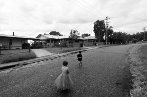 Two children on the main street of Bowraville mission. IMAGE: Chris Graham.