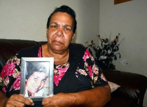 Colleen Walker's mother Murial Craig Walker holds a picture of her daughter. IMAGE: Chris Graham.